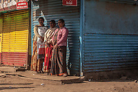 3 women waiting on the street in Ooty, India.