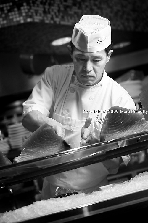 SHOT 4/1/09 11:02:57 AM - Sushi Den sushi chef Young Jo Kwon of Denver helps as the restaurant's sushi chefs prepare some 600 pounds of fresh fish shipped in from Japan at the Pearl Street sushi restaurant. Kwon has worked at the restaurant for about a year. Sushi Den is consistently ranked as one of Denver's best restaurants.  The owners strive to create one of the top sushi restaurants in the world by providing consistently fresh, innovative healthy foods using only the finest ingredients..(Photo by Marc Piscotty / © 2009)