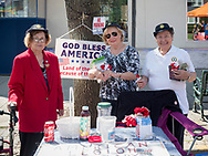 Merrick, New York, USA. September 9, 2017.  L-R, LUCY MURPHY, FLORENCE HOFFMAN, and MATTIA SARACENI, members of Merrick Auxiliary Unit of Merrick Post 1282 of American Legion distribute poppies for donations at the Merrick Fall Festival and Street Fair.