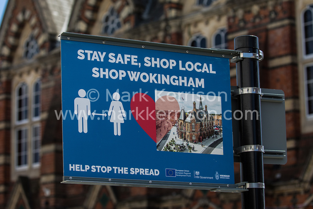 Wokingham, UK. 8th June, 2021. A sign in front of Wokingham Town Hall advises residents to use local shops amid rising concern regarding the spread of the Covid-19 Delta variant. Surge testing has been introduced in some local postcodes after a small number of cases of the Delta variant first identified in India were confirmed in the Wokingham area.