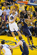Golden State Warriors guard Klay Thompson (11) takes the ball to the basket against Utah Jazz guard Rodney Hood (5) during Game 2 of the Western Conference Semifinals at Oracle Arena in Oakland, Calif., on May 4, 2017. (Stan Olszewski/Special to S.F. Examiner)