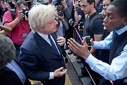 © London News Pictures. 09/08/11. Boris Johnson.  Mayor of London, Boris Johnson visits Clapham Junction during the mass public clean up of the streets. This event has been organised through the social media of Twitter which was attended by up to 350 twitters.
