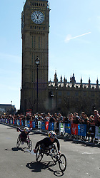 Tatyana McFadden who won the ill fated Boston wheelchair marathon event, on her way to winning the event in London with her team mate Amanda McGrory also of the USA passing Big Ben April 21, 2013. Photo by: Max Nash / i-Images