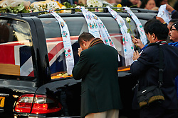 © Licensed to London News Pictures.  08/11/2011. CARTERTON, UK. Friends and family of L/Cpl Siddhanta Kunwar, 1st Battalion The Royal Gurkha Rifles, attached to 40 Commando Royal Marines pay their respects during a repatriation ceremony. The ceremony takes place three days before the Remembrance Sunday. Photo credit :  Cliff Hide/LNP