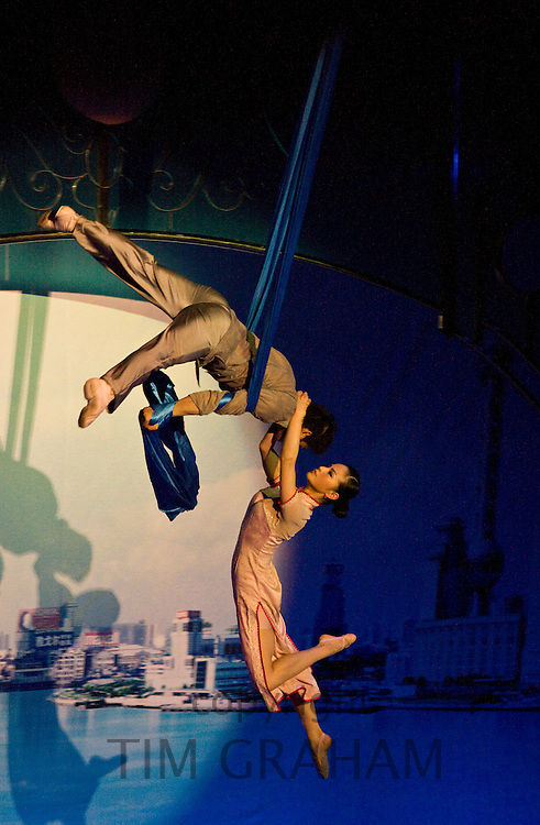 Members of the Shanghai Acrobatic Group performing at the Shanghai Centre Theatre, China