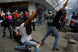 June 7, 2017 - Caracas, Capital District, Venezuela - Venezuelan opposition marching to the National Electoral Center (CNE) were attacked by security forces this June 7, 2017. The protest against the government of President Nicolas Maduro in the Venezuelan capital left several injured in the clashes against the National Police Bolivarian (PNB) and a young man killed by explosive. (Credit Image: © Adrian Manzol via ZUMA Wire)