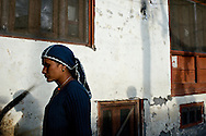 A woman living in a Kinnauri village who is not Kinnauri does not wear the traditional Kinnauri hat. She will wear clothing more distinctive of her background.