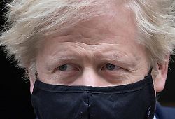 © Licensed to London News Pictures. 14/10/2020. London, UK. Prime Minister Boris Johnson leaves Number 10 Downing Street wearing a face mask. Mr Johnson will face MPs questions in Parliament today. Photo credit: Peter Macdiarmid/LNP