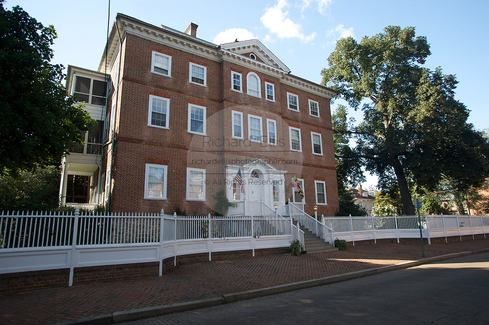 Chase-Lloyd House, a historic home on Maryland Street in Annapolis, Maryland. Build by Samuel Chase, signer of the Declaration of Independence.....The structure, one of the first three-story Georgian townhouses erected in the American Colonies, ranks among the finest of its type in the United States and is one of the major attractions in Colonial Annapolis Historic District. The house rises three full stories over a high basement. Two massive interior chimneys protrude through the broad, low, hip-on-hip roof. The brick walls are laid in Flemish bond and adorned by belt courses of rubbed brick at the second- and third-floor levels. An enriched cornice embellishes the roofline. At the front, or east, facade the axial line features a tall, projecting central pavilion and entranceway, an arched window on the third floor, and crowning pediment with a small bull's-eye window.