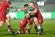 Ian Keatley (Treviso) tackled by Angus O'Brien (Scarlets) and Steff Hughes (Scarlets) during the Guinness Pro 14 Rugby Union match between Benetton Treviso and Scarlets Rugby on October 23, 2020 at Stadio Comunale di Monigo in Treviso, Italy - Photo Ettore Griffoni / LM / ProSportsImages / DPPI