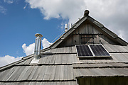A Slovenian herder's mountain holiday hut using solar power in Velika Planina, on 26th June 2018, in Velika Planina, near Kamnik, Slovenia. Velika Planina is a mountain plateau in the Kamnik–Savinja Alps - a 5.8 square kilometres area 1,500 metres (4,900 feet) above sea level. Otherwise known as The Big Pasture Plateau, Velika Planina is a winter skiing destination and hiking route in summer. The herders' huts became popular in the early 1930s as holiday cabins (known as bajtarstvo) but these were were destroyed by the Germans during WW2 and rebuilt right afterwards by Vlasto Kopac in the summer of 1945.