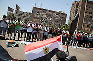 Muslim Brotherhood supporters gather in Cairo to pray, at a rally in solidarity with Morsi.