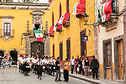 A marching band escorts a statue of Saint Michael in a religious procession through the city at the start of the week long fiesta of the patron saint Saint Michael  September 21, 2017 in San Miguel de Allende, Mexico.