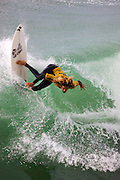 Rob Machado competing in the Katin Pro/Am surf competition at Huntington Beach Pier, Orange County, California.