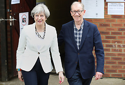 Prime Minister Theresa May and her husband Philip leave after casting their votes in the General Election at a polling station in the village of Sonning, Berkshire.