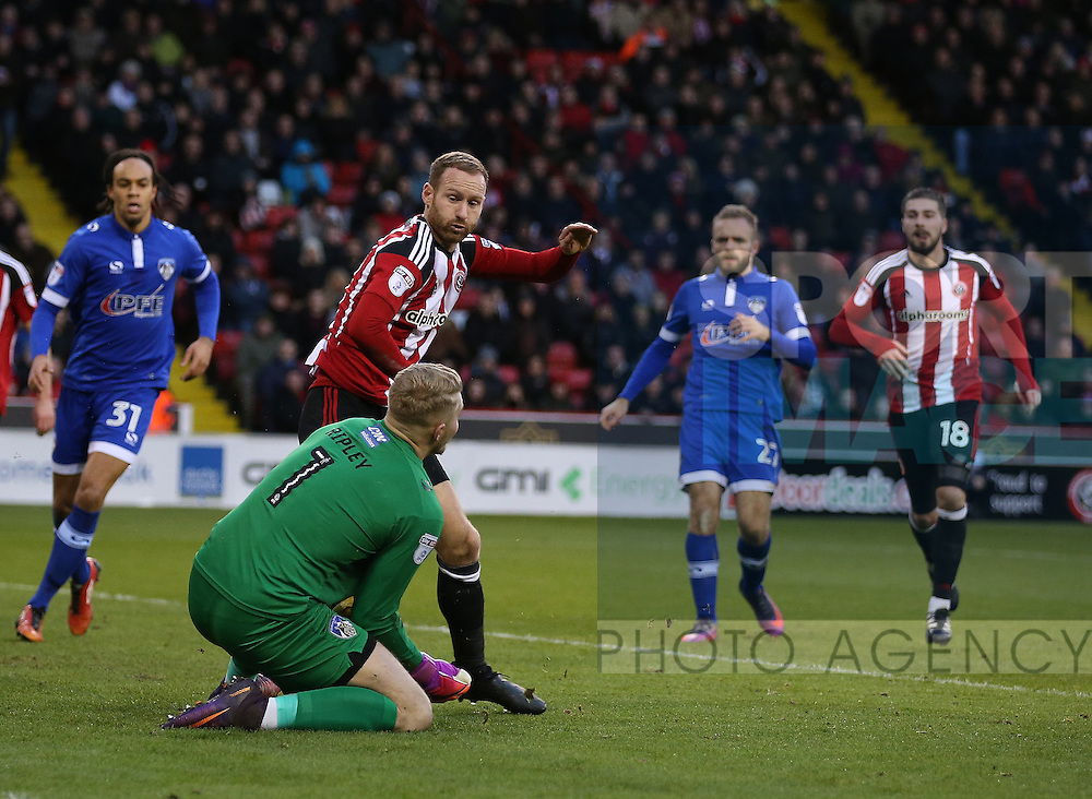 Matt Done of Sheffield Utd has his shot saved by Connor Ripley of Oldham during the English League One match at Bramall Lane Stadium, Sheffield. Picture date: December 26th, 2016. Pic Simon Bellis/Sportimage