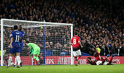 Manchester United's Paul Pogba (second right) celebrates scoring his side's second goal of the game during the FA Cup fifth round match at Stamford Bridge, London.
