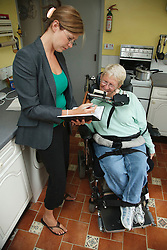 Social Worker visiting woman with Cerebral Palsy in own home.