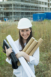 Young architect holding construction plans