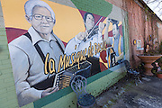 Mural painted along a building of Cajun accordionist Nathan Abshire, Cajun fiddlers Dewey Balfa, and Harry Choates in Basile, Louisiana.