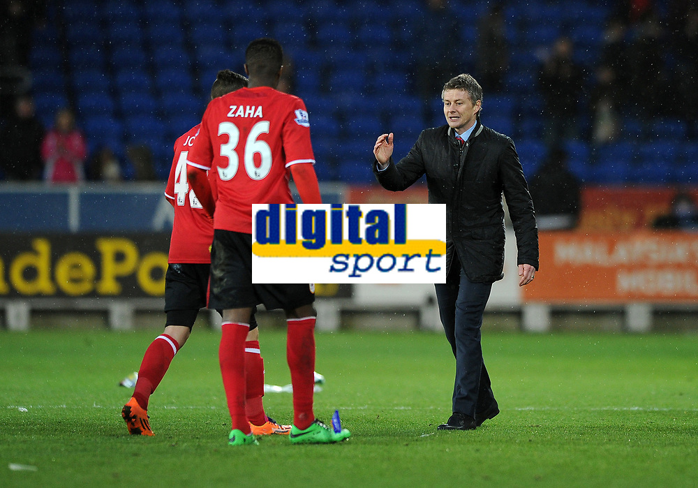 Football - 2013 / 2014 Premier League - Cardiff City vs. Norwich City<br /> Ole Gunnar Solskjaer Manager of Cardiff City celebrates their win with debutant Wilfred Zaha at the Cardiff City Stadium