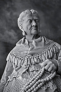 """Picture and image of the stone sculptured  funeral monument of Caterina Campodonico, also called """"The Peanuts Seller"""" carrying a string of peanuts and donuts that she sold on the streets of Genoa. Completed while she was still alve by sculptor Lorenzo Orengo, who was the most important artist of the Bourgeois Realism, greatly sought after by the member of the middle class. The Staglieno Monumental Cemetery, Genoa, Italy .<br /> <br /> Visit our PEOPLE & PLACES PHOTO ART COLLECTIONS for more photos to buy as buy as wall art prints https://www.photoshelter.com/mem/images/index#/C00001WetsxVxNTo/ .<br /> <br /> Visit our LANDSCAPE PHOTO ART PRINT COLLECTIONS for more wall art photos to browse https://funkystock.photoshelter.com/gallery-collection/Places-Landscape-Photo-art-Prints-by-Photographer-Paul-Williams/C00001WetsxVxNTo"""