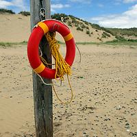Europe, Ireland, Brittas Bay. Irish Life Preserver Ring at Brittas Bay.