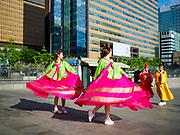 SEOUL, SOUTH KOREA: Tourists try on Korean traditional royal clothing near the King Sejong Statue in Seoul.       PHOTO BY JACK KURTZ