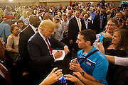 "Republican Presidential candidate Donald Trump signs an autograph for a supporter during his ""Make America Great Again Rally"" at the Grand River Center in Dubuque, Iowa, Tuesday, August 25, 2015. REUTERS/Ben Brewer"