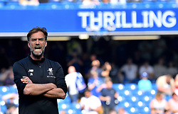 Liverpool manager Jurgen Klopp watches his players warm up before the Premier League match at Stamford Bridge, London.