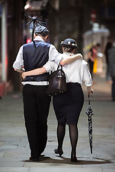 © Licensed to London News Pictures . 27/12/2016 . Wigan , UK . A man and a woman dressed as a chimney sweep and Mary Poppins . Revellers in Wigan enjoy Boxing Day drinks and clubbing in Wigan Wallgate . In recent years a tradition has been established in which people go out wearing fancy-dress costumes on Boxing Day night . Photo credit : Joel Goodman/LNP