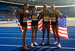 (L-R) Sanya Richards, Allyson Felix, Lashinda Demus, Debbie Dunn of the United States celebrate winning the gold medal in the women's 4x400 Metres Relay Finalduring day nine of the 12th IAAF World Athletics Championships at the Olympic Stadium on August 23, 2009 in Berlin, Germany. (Photo by Vid Ponikvar / Sportida)
