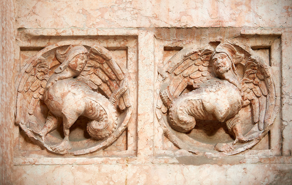 Medieval relief sculptures of mythical half human creatures on the exterior of the Romanesque Baptistery of Parma, circa 1196, (Battistero di Parma), Italy .<br /> <br /> If you prefer you can also buy from our ALAMY PHOTO LIBRARY  Collection visit : https://www.alamy.com/portfolio/paul-williams-funkystock/romanesque-art-antiquities.html<br /> Type -     Parma    - into the LOWER SEARCH WITHIN GALLERY box. <br /> <br /> Visit our ROMANESQUE ART PHOTO COLLECTION for more   photos  to download or buy as prints https://funkystock.photoshelter.com/gallery-collection/Medieval-Romanesque-Art-Antiquities-Historic-Sites-Pictures-Images-of/C0000uYGQT94tY_Y