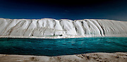 Melt River, Petermann Glacier, Greenland - a river flowing on ice, which is itself a floating ice tongue, floating on a fjord.  In 2010 and 2012 Petermann calved ice islands totalling 400 square kilometres.<br />