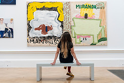 © Licensed to London News Pictures. 15/09/2021. LONDON, UK. 'MIRANDA, TWICE AND CALIBAN' by Rose Wylie RA, price Not For Sale. Preview of the Summer Exhibition 2021 at the Royal Academy of Arts in Piccadilly. Co-ordinated by Yinka Shonibare RA, the exhibition explores the theme of 'Reclaiming Magic' to celebrate the joy of creating art with around 1400 works by emerging and established artists featured in the exhibition.  The Summer Exhibition is the world's largest open submission contemporary art show and has taken place every year without interruption since 1769.  Photo credit: Stephen Chung/LNP