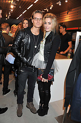 OLIVER PROUDLOCK and CHELSEA LEYLAND at an invitation-only acoustic performance by Rita Ora hosted by Calvin Klein Jeans at their Regent Street Store, London on 18th February 2013.
