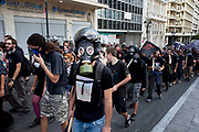 Masked students demonstrate against austerity measures and planned education reforms in Athens. The demonstration is against an education reform bill which aims to improve the operation of universities.