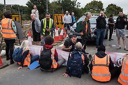 Motorists plead with Insulate Britain climate activists blocking a slip road from the M25 at Junction 25 as part of a campaign intended to push the UK government to make significant legislative change to start lowering emissions on 15th September 2021 in Enfield, United Kingdom. The activists, who wrote to Prime Minister Boris Johnson on 13th August, are demanding that the government immediately promises both to fully fund and ensure the insulation of all social housing in Britain by 2025 and to produce within four months a legally binding national plan to fully fund and ensure the full low-energy and low-carbon whole-house retrofit, with no externalised costs, of all homes in Britain by 2030 as part of a just transition to full decarbonisation of all parts of society and the economy.