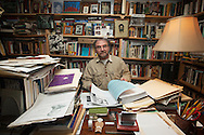 February 28, 2013 - Michael Boover '74, Ph.D, in his office at his home in Worcester. Boover's new book, 15 Days of Prayer with Dorothy Day, can be found on bookshelves in the Fall. (MATT WRIGHT for Worcester State University)