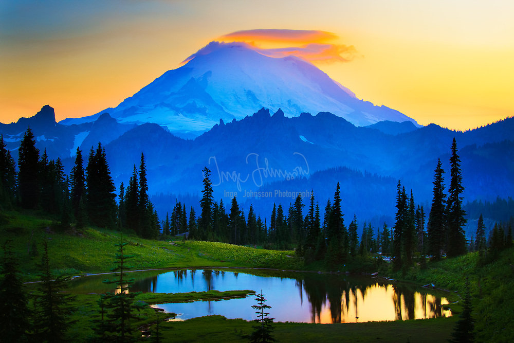 Mount Rainier at sunset with a slightly lenticular cloud above its peak.  Seen from the east side near Tipsoo Lake.