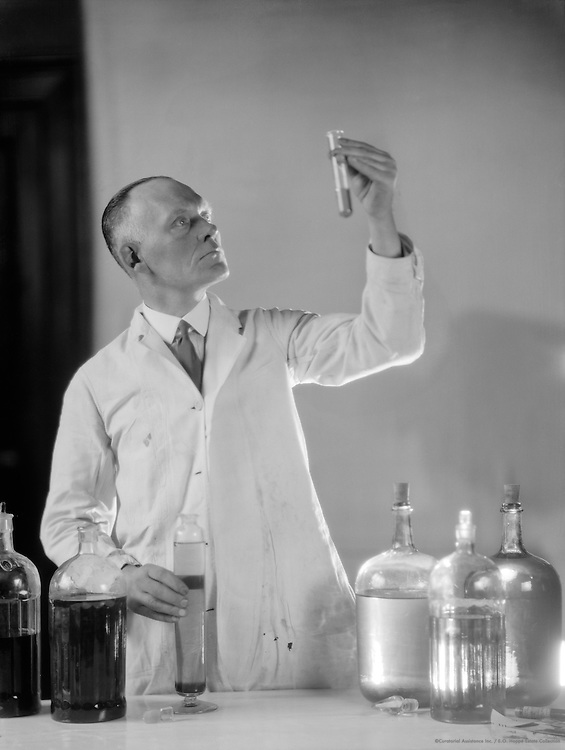 Mr. Bisping, chemist, performing a laboratory test, 1931