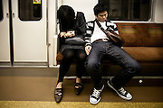 TOKYO, JAPAN, 4 MAY - Yurakucho line - A couple asleep in the metro. May 2010