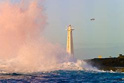 airplane and wave crashing on lighthouse, Kona, Big Island, Hawaii, Pacific Ocean