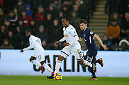 Renato Sanches of Swansea city breaks away from Ben Davies of Tottenham Hotspur.  Premier league match, Swansea city v Tottenham Hotspur at the Liberty Stadium in Swansea, South Wales on Tuesday 2nd January 2018. <br /> pic by  Andrew Orchard, Andrew Orchard sports photography.