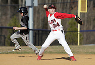 Chester, New York  - An infielder throws to first base as a runner rounds the bases during the TRUMP March Madness youth baseball tournament at The Rock Sports Park on March 17, 2012.