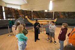 Washington, DC: National Museum of the American Indian.  Native American docent explains museum to group.  Photo # wash99307-70680..Photo copyright Lee Foster, www.fostertravel.com, lee@fostertravel.com, 510/549-2202