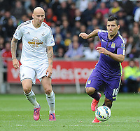 Swansea City's Jonjo Shelvey battles with Manchester City's Sergio Aguero <br /> <br /> <br /> Photographer Ashley Crowden/CameraSport<br /> <br /> Football - Barclays Premiership - Swansea City v Manchester City - Sunday 17th May 2015 - Liberty Stadium - Swansea<br /> <br /> © CameraSport - 43 Linden Ave. Countesthorpe. Leicester. England. LE8 5PG - Tel: +44 (0) 116 277 4147 - admin@camerasport.com - www.camerasport.com