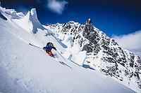 Joe Morabito and Loft Peak Glacier with Hut Peak in the background, Howson Range, British Columbia.