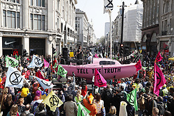 © Licensed to London News Pictures. 15/04/2019. London, UK. Extinction Rebellion members block Oxford Circus with a pink painted boat during a day of coordinated actions and blockades throughout London and other UK cities to highlight global climate change. Photo credit: Peter Macdiarmid/LNP