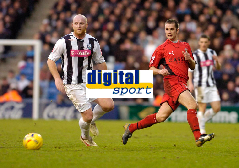 Photo: Leigh Quinnell.<br /> West Bromwich Albion v Coventry City. Coca Cola Championship. 16/12/2006. Coventrys Michael Doyle gets the ball away from West Broms  John Hartson.